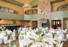 Reception setup with many round tables and one long rectangular table for the bridal party