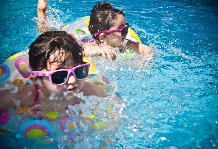 Girls on intertubes enjoying the pool.